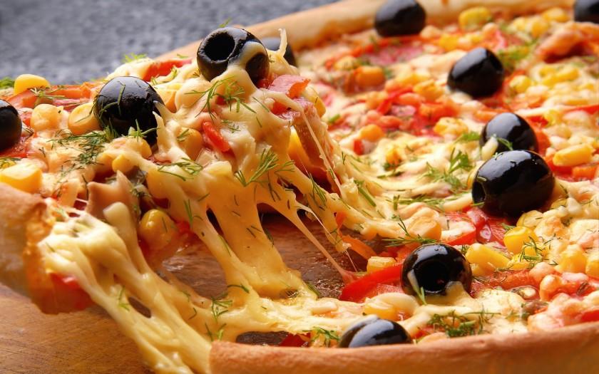 Según la ciencia, la pizza nos hace felices